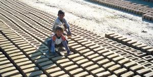 Children working on brick kiln